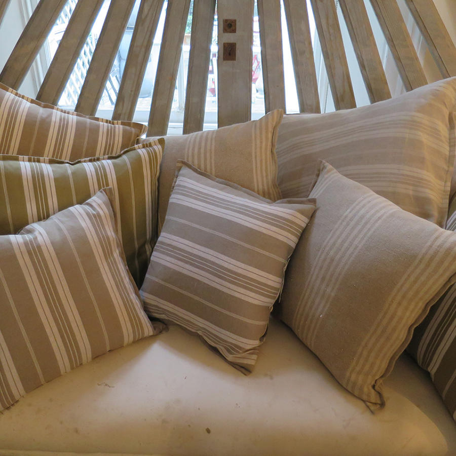 Various old Ticking Cushions