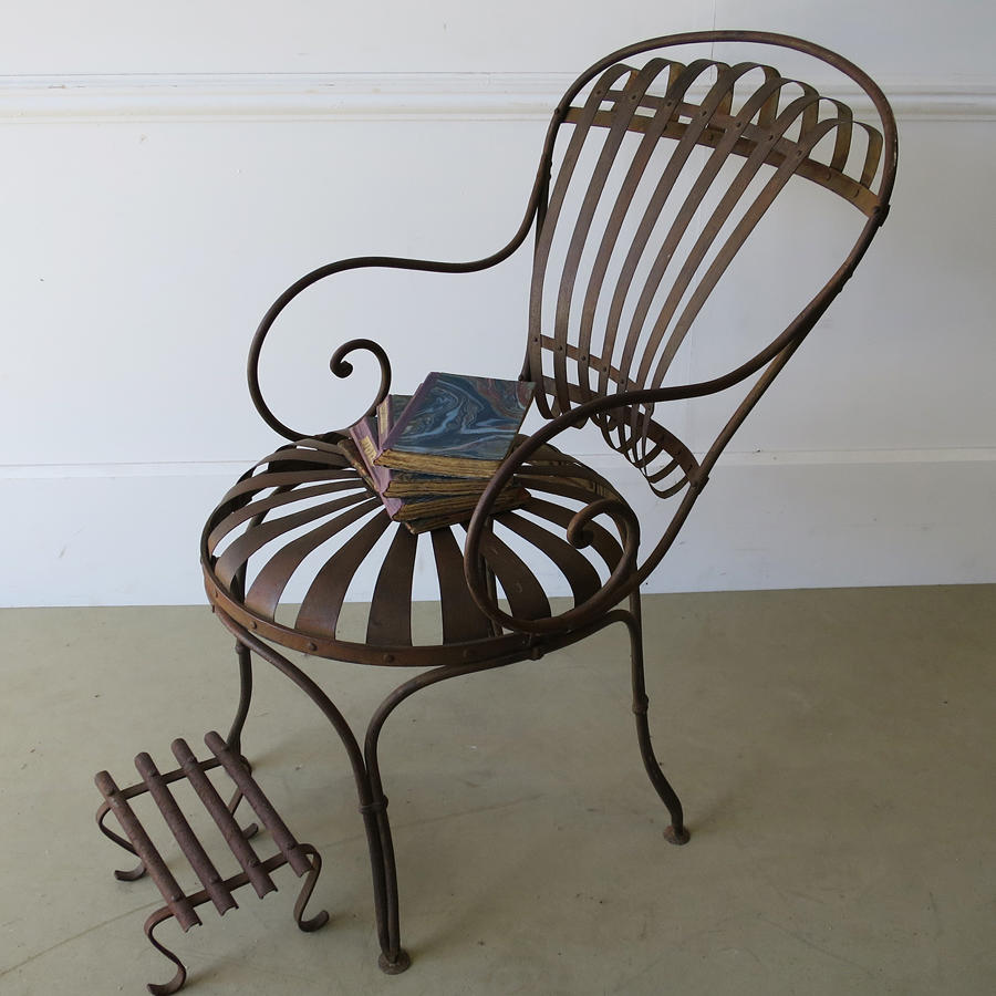 Single Iron sprung arm chair with footstool circa 1880