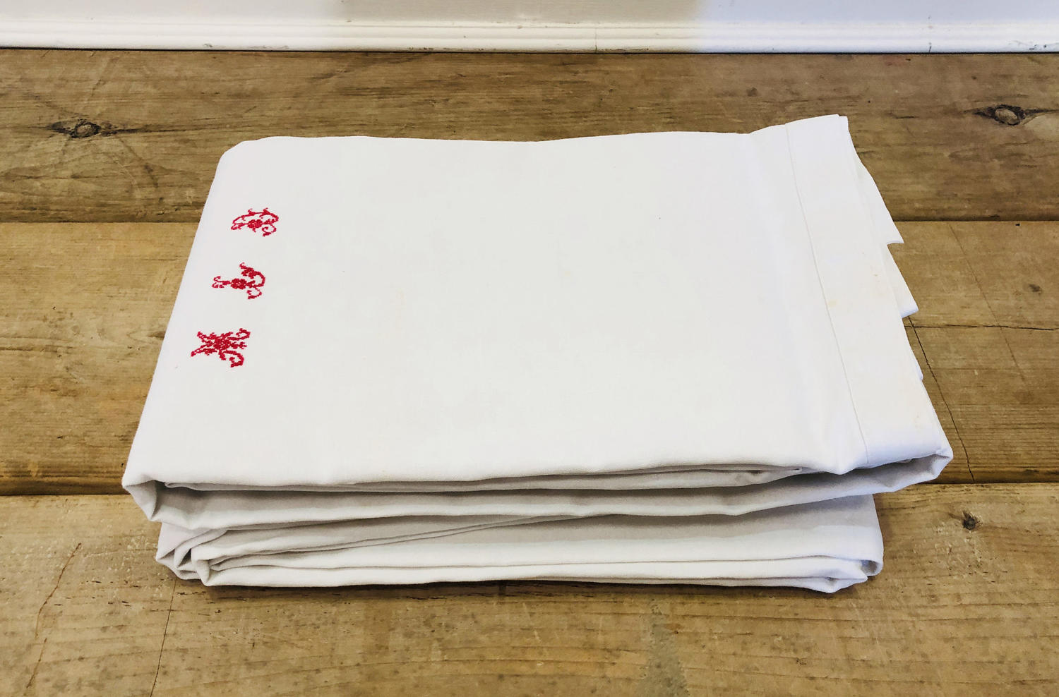 Pair of large French Sheets - red monogram M.L.D.