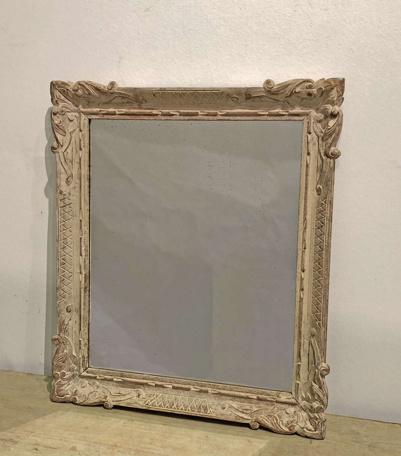 Small French carved mirror with remains of old paint - circa 1900