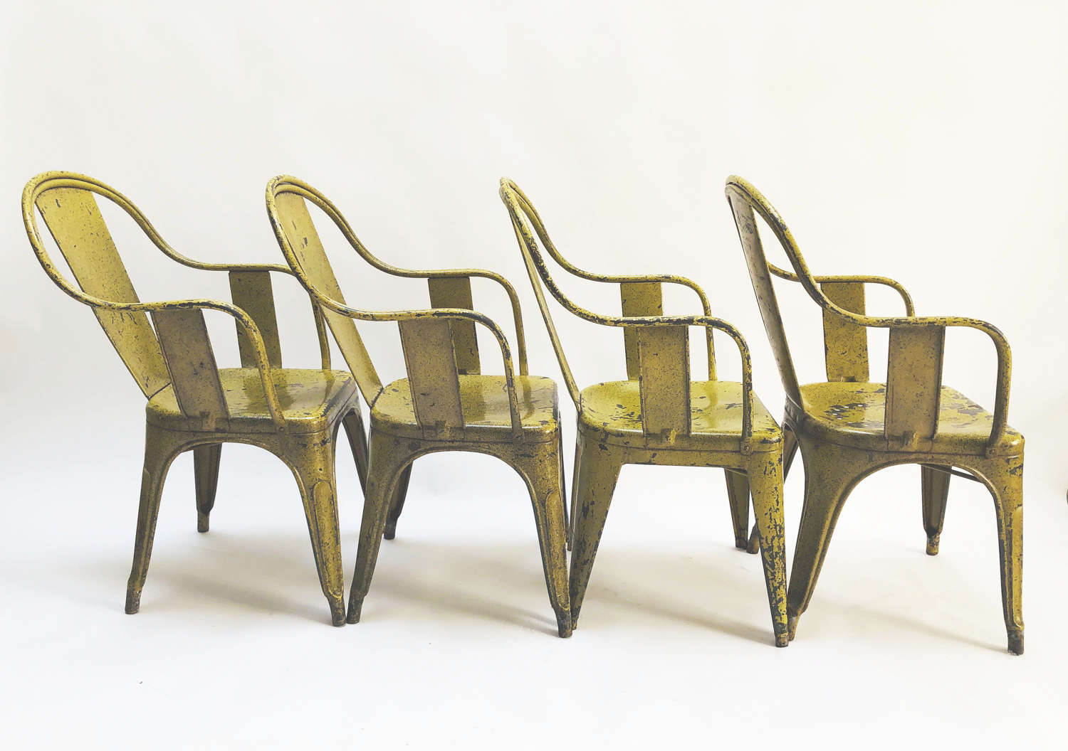 Set of 4 French Tolix Armchairs with original yellow finish - c 1920