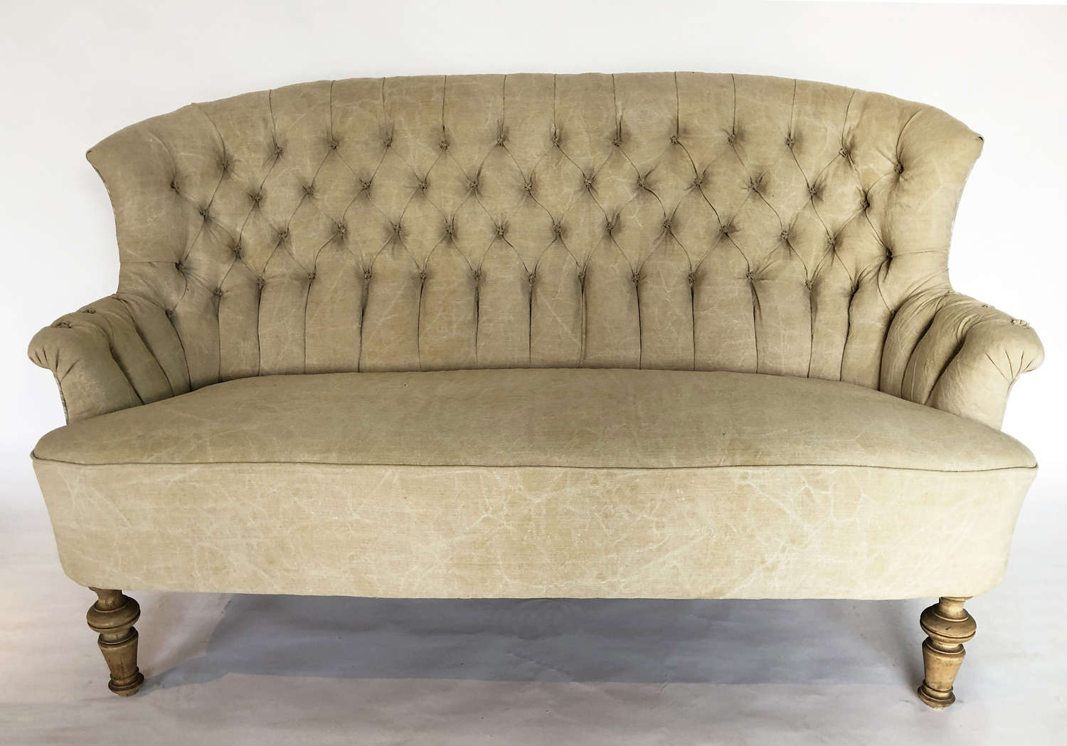 Small curved French Sofa with buttoned back circa 1930