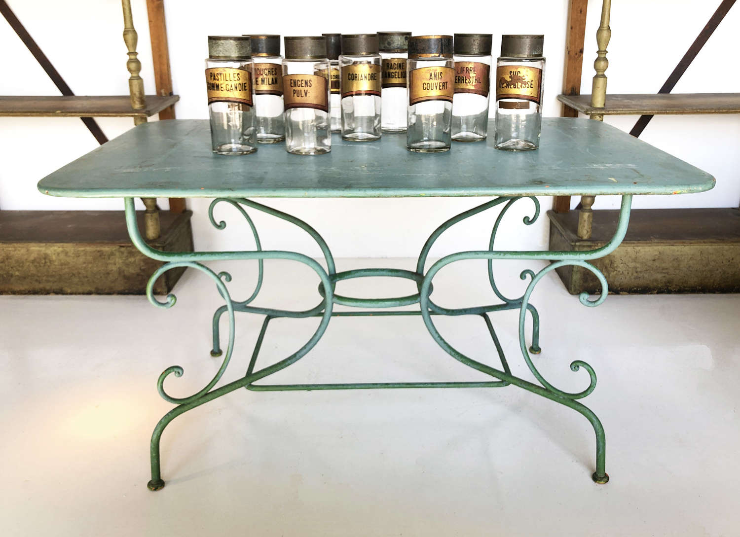 A classic 19th c French Wrought Iron Garden Table with old green paint