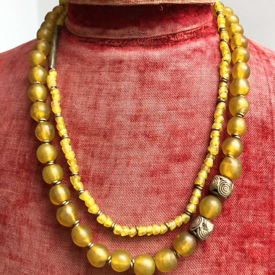 Unusual Old Yellow Glass Beads with brass details